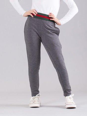 Ciemnoszare dziewczęce spodnie dresowe z kieszeniami