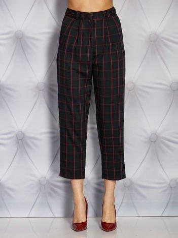 Ciemnozielone materiałowe spodnie w kratkę