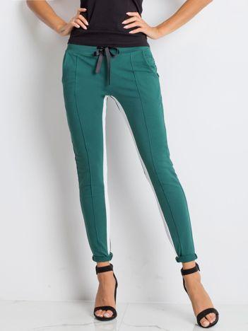 Ciemnozielone spodnie dresowe Defined
