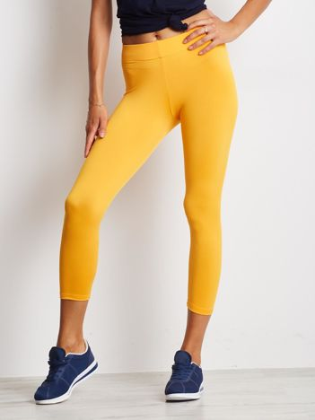 Cienkie legginsy fitness o długości 3/4 pomarańczowe