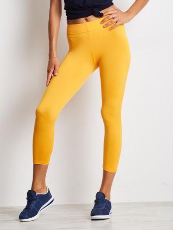 Cienkie legginsy fitness o długości 7/8 pomarańczowe