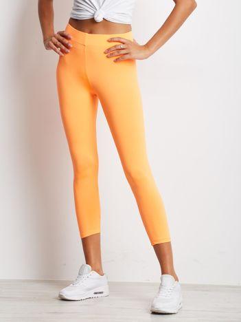 Cienkie legginsy sportowe o długości 7/8 fluo pomarańczowe