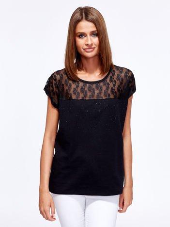 Czarna bluzka z ażurową wstawką przy dekolcie