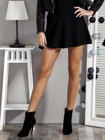 Czarna spódnica damska z falbanami
