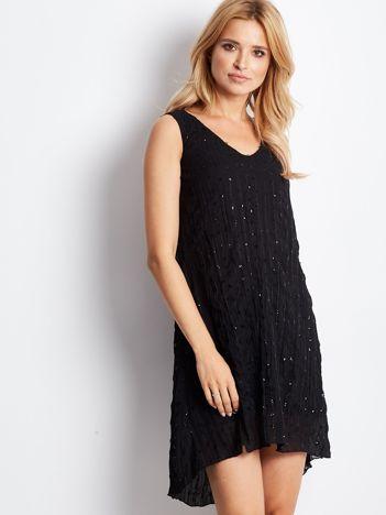 Czarna sukienka z cekinami i wiązaniem z tyłu