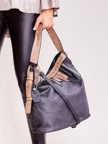 Czarna torba z ozdobnymi wstawkami
