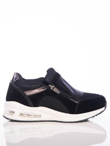 Czarne buty sportowe z poduszką powietrzną w podeszwie i lustrzanymi wstawkami