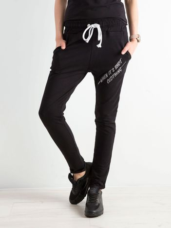 Czarne damskie spodnie dresowe z dżetami