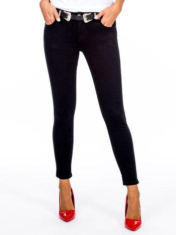 Czarne dopasowane spodnie damskie z paskiem