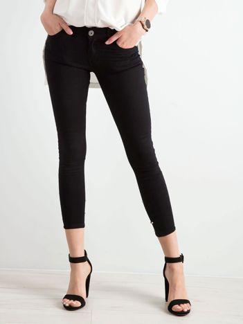 Czarne jeansy biodrówki