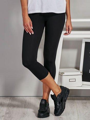 Czarne legginsy damskie z przeszyciami