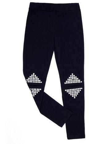 Czarne legginsy dla dziewczynki z rozcięciami i aplikacją
