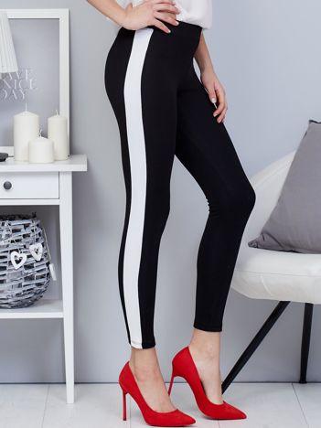 Czarne legginsy z białym lampasem