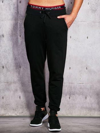 Czarne spodnie dresowe męskie z kieszeniami na suwak