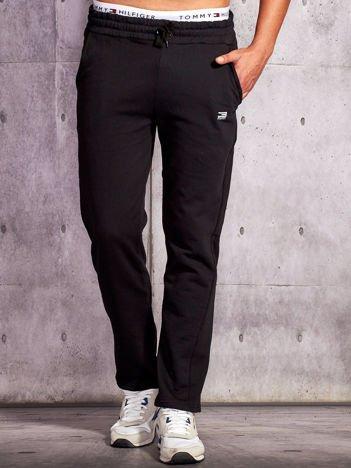 Czarne spodnie dresowe męskie z troczkami