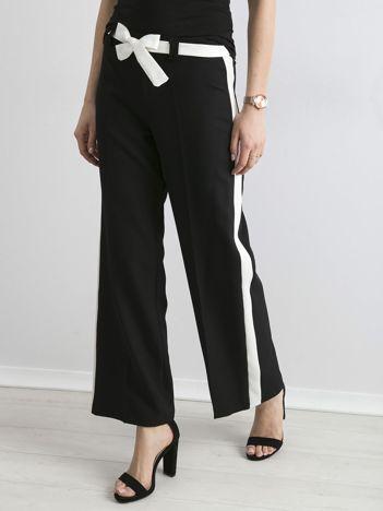 Czarne szerokie spodnie z lampasami