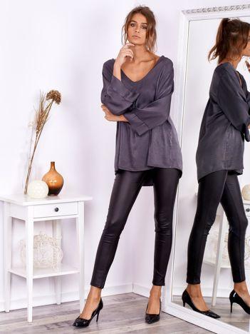 Czarne woskowane spodnie rurki skinny