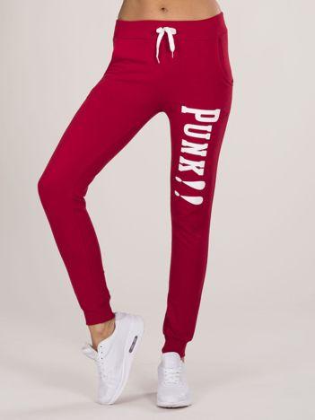 Czerwone spodnie dresowe z napisem