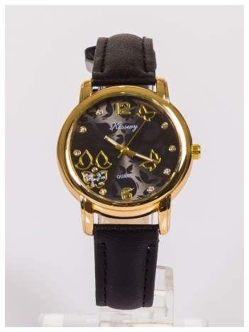 Damski zegarek z ozdobnym datownikiem na tarczy.