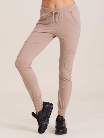 Damskie spodnie dresowe ze ściągaczami beżowe