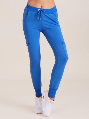 Damskie spodnie dresowe ze ściągaczami niebieskie