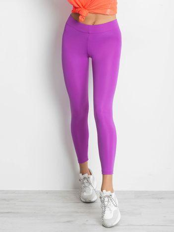 Długie fluo fioletowe legginsy fitness o średniej grubości
