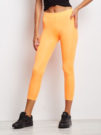 Długie fluo pomarańczowe legginsy fitness o średniej grubości
