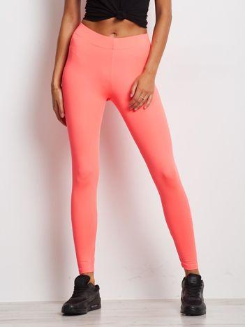 Długie fluo różowe legginsy fitness o średniej grubości