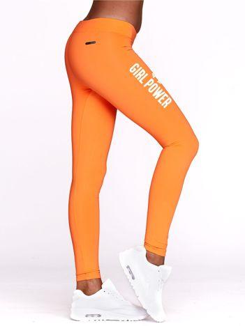 Długie fluopomarańczowe legginsy do fitnessu GIRL POWER z nadrukiem