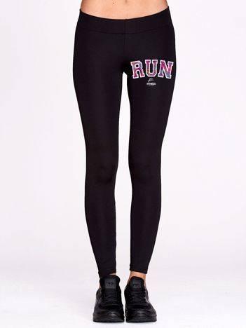 Długie legginsy do fitnessu ze sportowym napisem czarne
