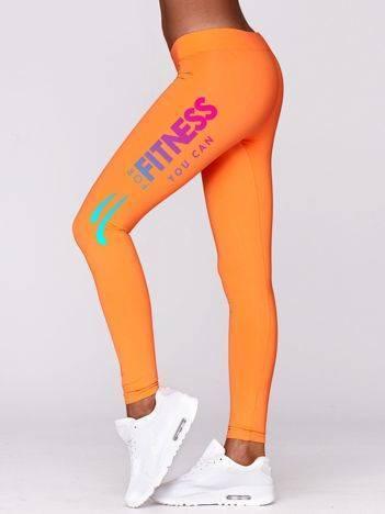 Długie legginsy fitness z tęczowym napisem fluo pomarańczowe