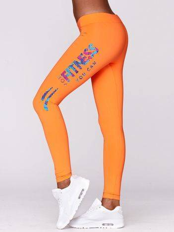 Długie legginsy na siłownię w sportowym stylu fluo pomarańczowe
