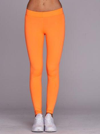 Długie lekko ocieplane legginsy sportowe fluo pomarańczowe