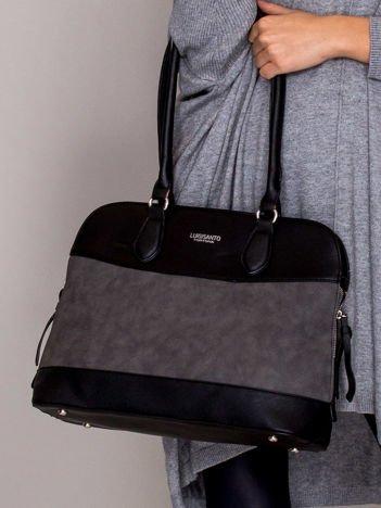 Elegancka trapezowa torebka z ozdobnymi suwakami czarna