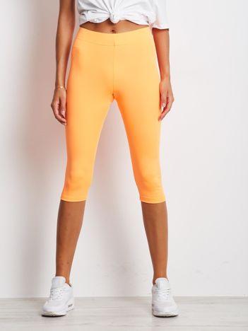 Fluo pomarańczowe krótkie legginsy fitness o średniej grubości