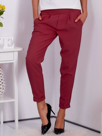 Gładkie ciemnoróżowe spodnie ze zwężaną nogawką
