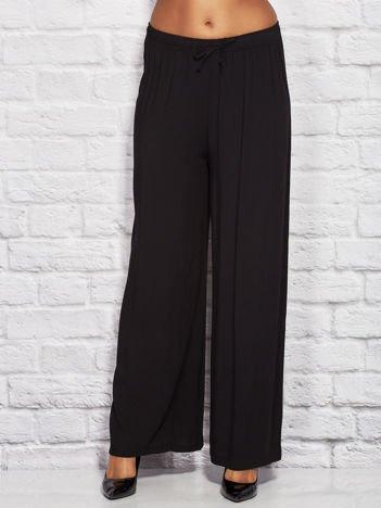 Gładkie luźne marszczone spodnie czarne