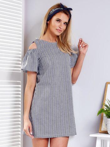 Granatowa sukienka w kratkę z falbankami na rękawach