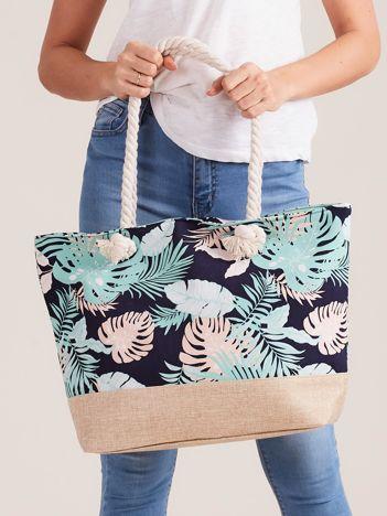 Granatowa torba z motywem roślinnym