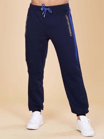 Granatowe męskie spodnie dresowe