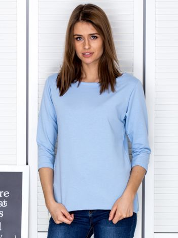 Jasnoniebieska bluzka z bocznymi suwakami