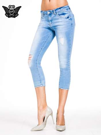 Jasnoniebieskie jeansy 3/4 skinny jeans z dziurą na kolanie