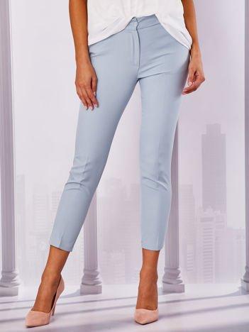 Jasnoniebieskie spodnie z lampasami