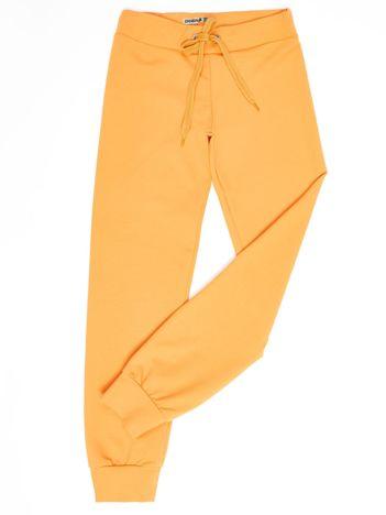 Jasnopomarańczowe dresowe spodnie dziecięce