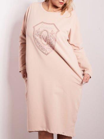 Jasnoróżowa dresowa sukienka z kieszeniami PLUS SIZE