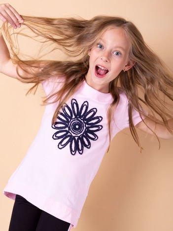 Jasnoróżowa tunika dla dziewczynki z kwiatem