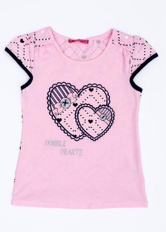 Jasnoróżowy t-shirt dla dziewczynki z sercami