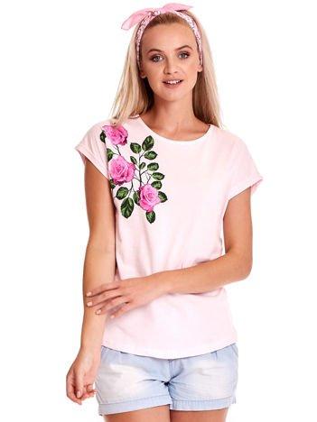 Jasnoróżowy t-shirt z nadrukiem róż