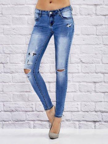 Jeansowe spodnie z haftem niebieskie