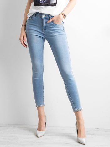 Jeansy z aplikacją na nogawkach niebieskie